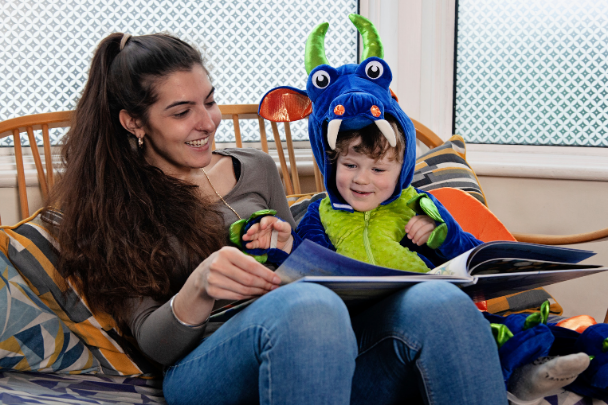 Childminder looks after a child in a monster suit