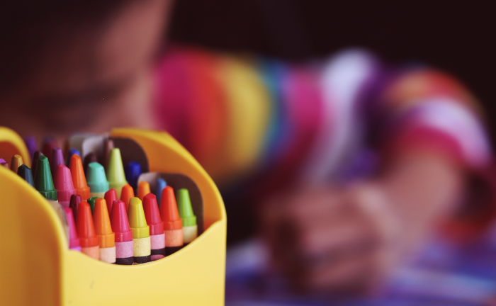 A child colours using crayons at the childminder's home