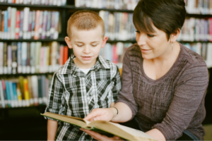 Ofsted childminder showing a child a book