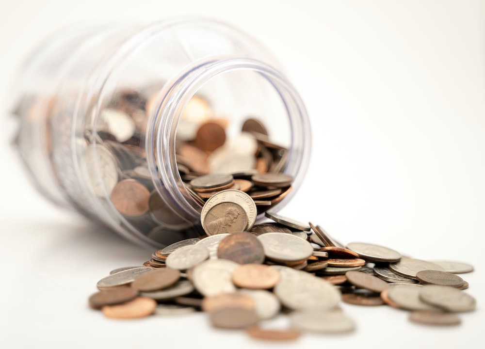 A pot of pension money spilling out onto a table