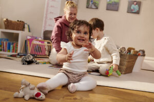childminder playing in her home with children